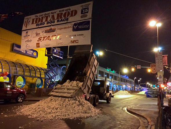 Snow is trucked in on March 7, 2015, for the ceremonial Iditarod start line in Anchorage, Alaska