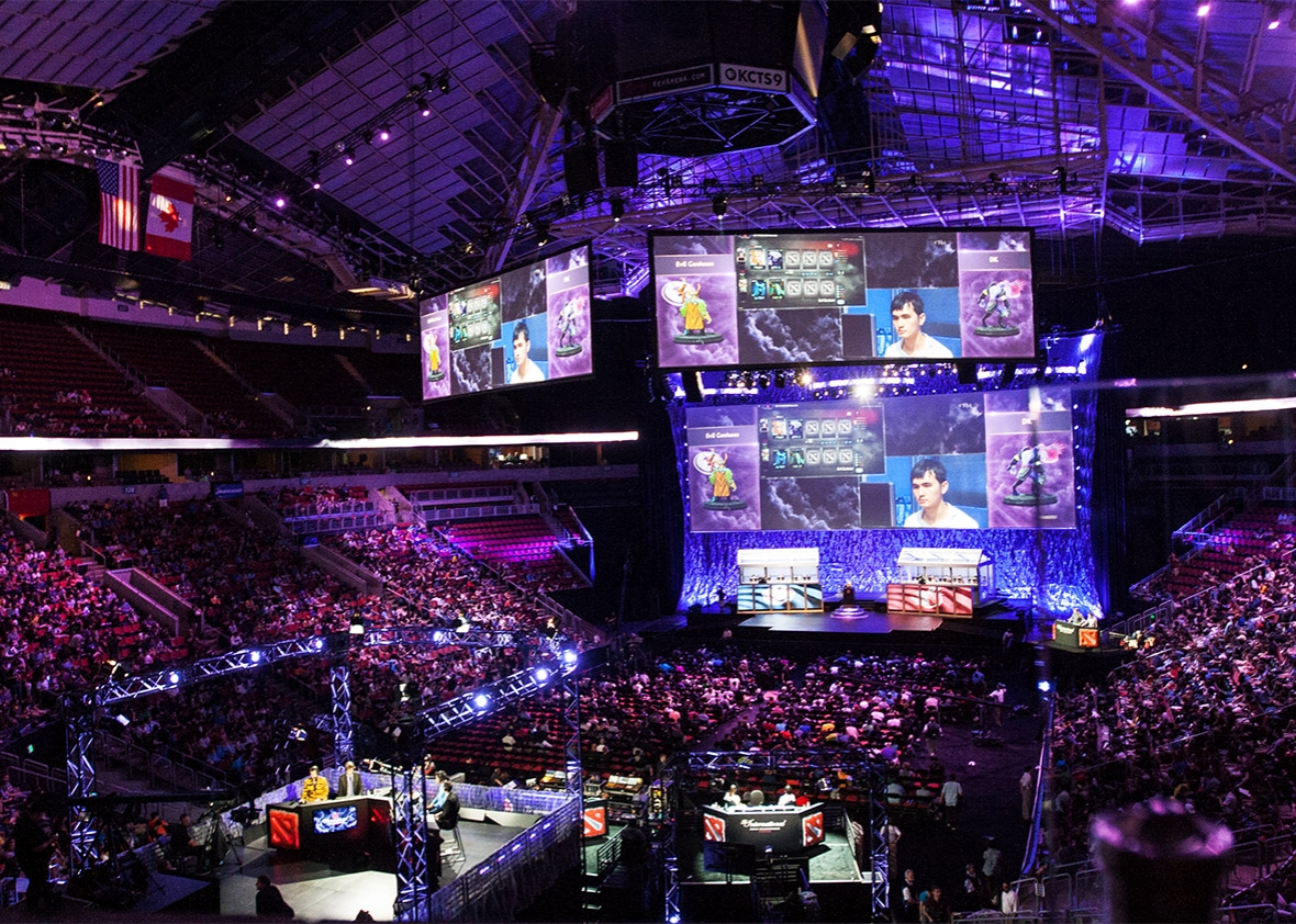 The stage and crowd at KeyArena for The International 2014.