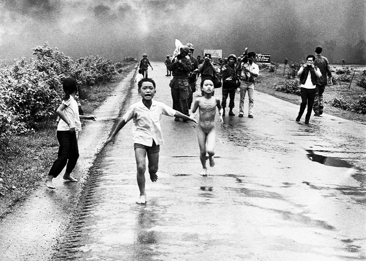 Vietnamese children flee from their homes in the South Vietnamese village of Trang Bang after South Vietnamese planes accidently dropped a napalm bomb on the village, located 26 miles outside of Saigon.