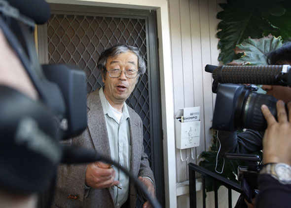 Dorian Nakamoto, widely believed to be Bitcoin currency founder, is surrounded by reporters as he leaves his home in Temple City, California March 6, 2014.