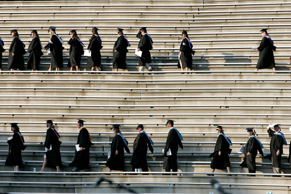 Graduating students enter the Paladin stadium before U.S. President George W. Bush watches them during the commencement ceremony at Furman University in Greenville, South Carolina May 31, 2008.