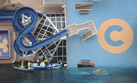 Cruise ship Costa Concordia lies stricken off the shore of the island of Giglio.