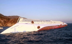 A photograph taken early on January 14, 2012 of the Costa Concordia after the cruise ship with more than 4,000 people on board ran aground and keeled over off the Isola del Giglio, Italy.