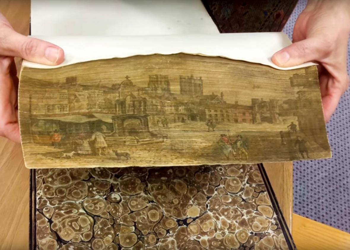 Artists hid secret paintings along the edges of old books (VIDEO).