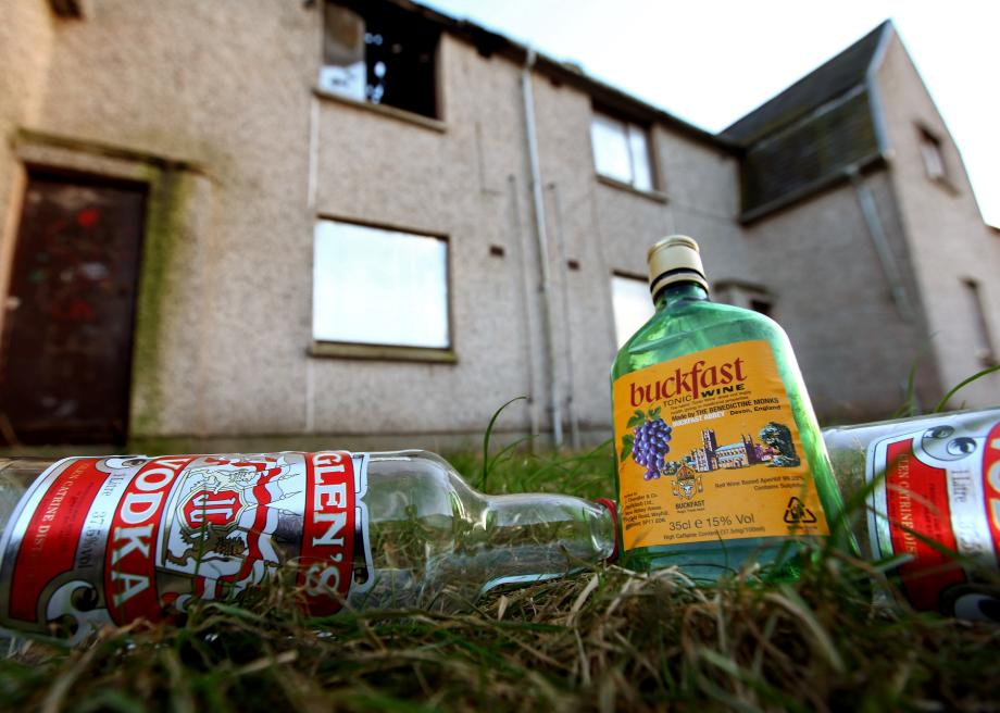 96552688-empty-bottles-of-vodka-and-buckfast-lay-outside-disused