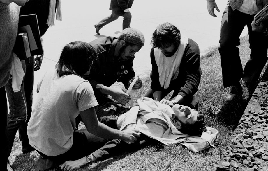 Wounded Kent State student John Cleary is attended to by other students, who helped save his life, May 4, 1970.