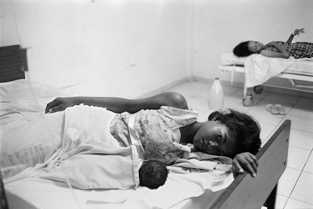 A patient with her newborn baby at the Juan Pablo Pina public hospital in San Cristóbal, Dominican Republic.