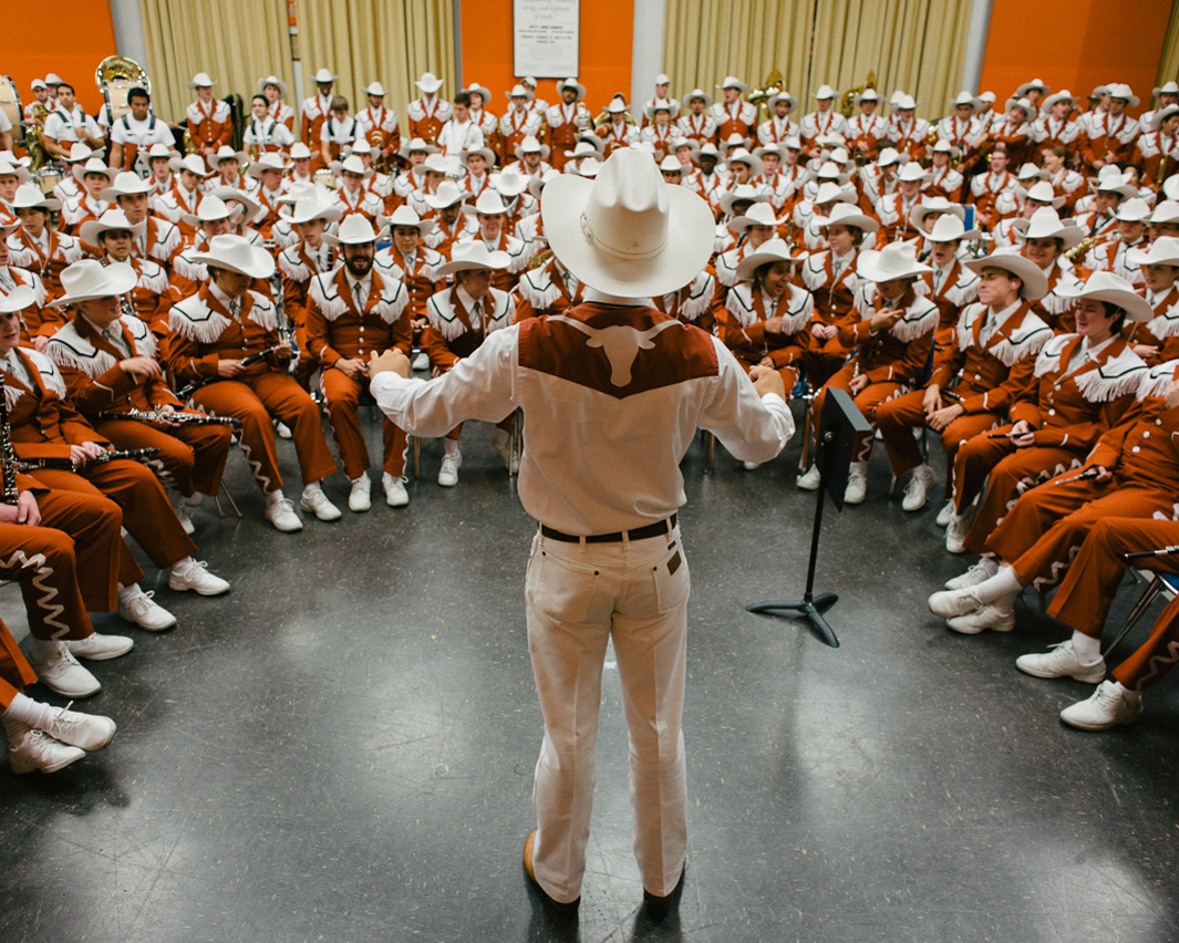 Drum Major. Alex Judd, Drum Major, prepares the Longhorn Band for game day, The University of Texas Longhorn Band, Austin, Texas.