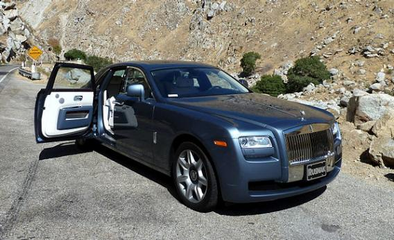 A Rolls-Royce Ghost with rear suicide doors. & Why Kanye West Jay-Z and Other Hip Hop Artists Rap About Suicide Doors