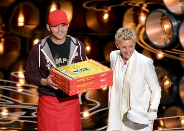 476275539-host-ellen-degeneres-with-pizza-delivery-man-onstage