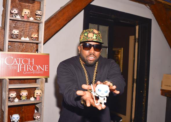 469787543-rapper-and-host-big-boi-with-a-game-of-thrones-pop-doll
