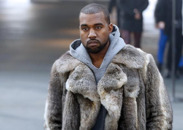 463224281-musician-kanye-west-arrives-to-attend-givenchys-fall