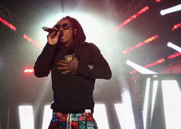 478498523-rapper-lil-wayne-speaks-onstage-at-the-2014-mtvu-woodie