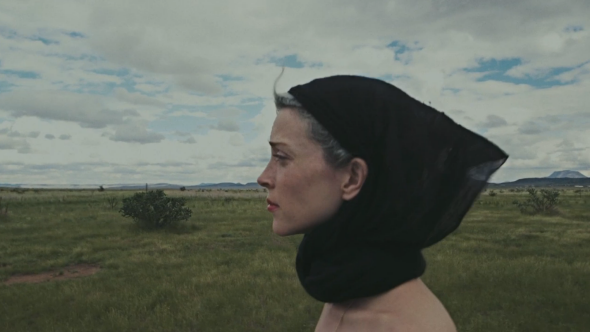 St. Vincent stares out at the Texas landscape.