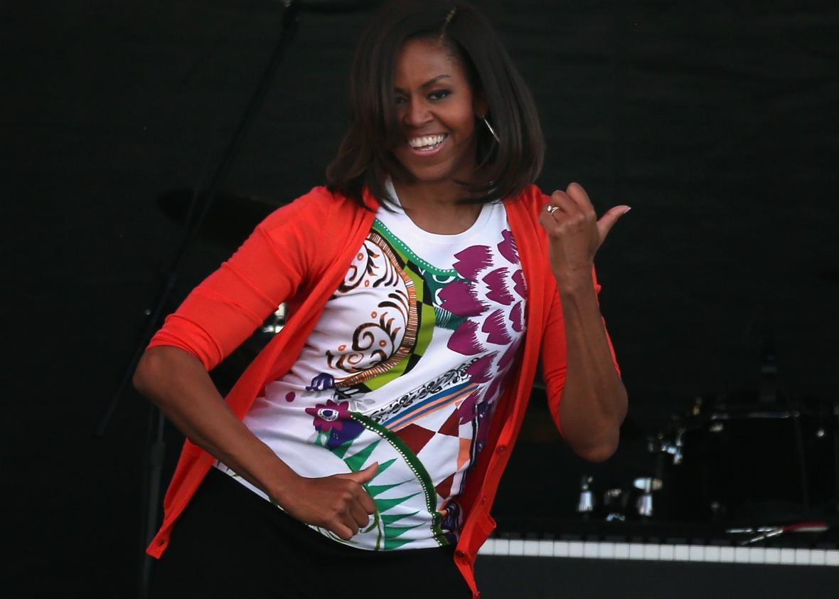 468741734-first-lady-michelle-obama-dances-with-members-of-the