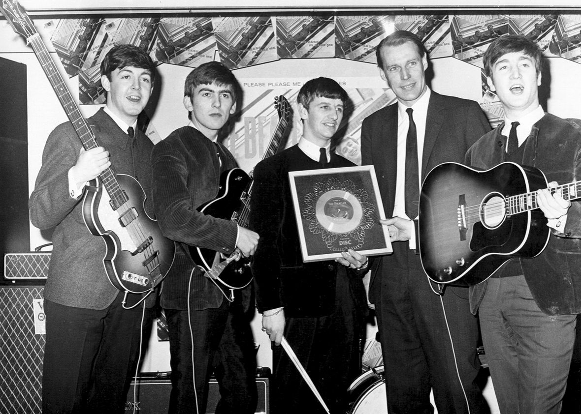 The Beatles with George Martin, circa 1964.