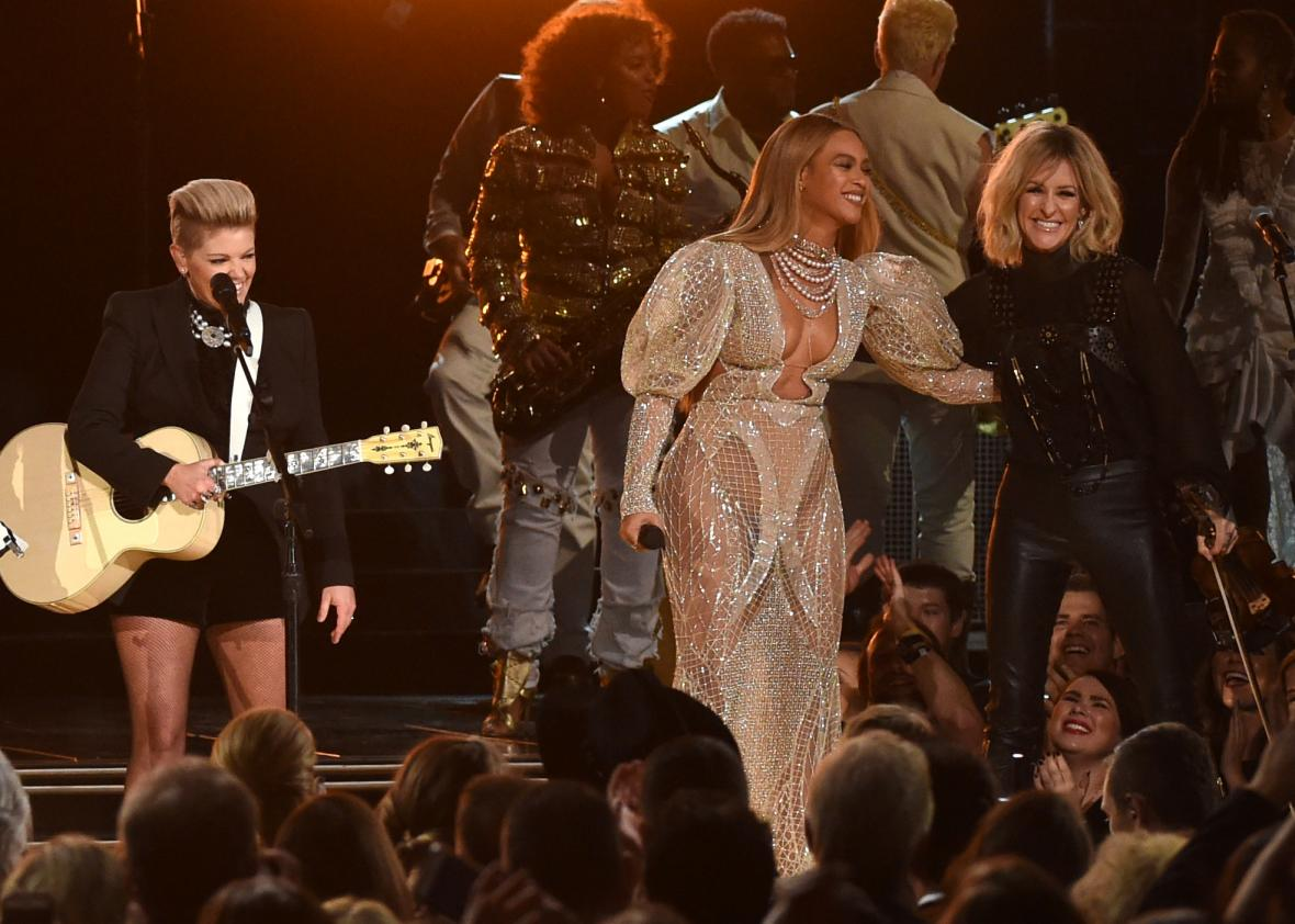 The grammys country music committee rejected beyoncs daddy lessons 620680996 beyonce performs onstage with martie maguire of stopboris Image collections