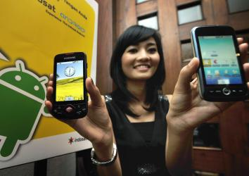 A model displays smartphones with Google's mobile operating system Android during its first launch in Jakarta on Feb. 22, 2010.