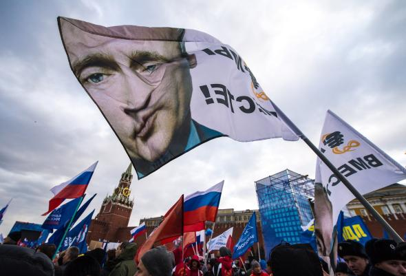 479367837-with-a-flag-depicting-president-vladimir-putin-pro