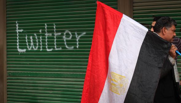 108817113-shop-in-tahrir-square-is-spray-painted-with-the-word
