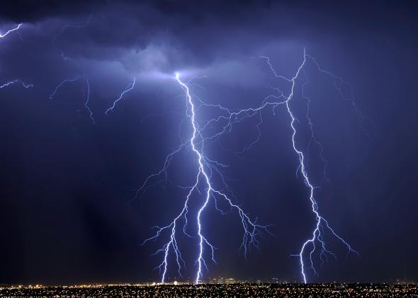 124828877-lightning-flashes-over-hotel-casinos-in-downtown-las