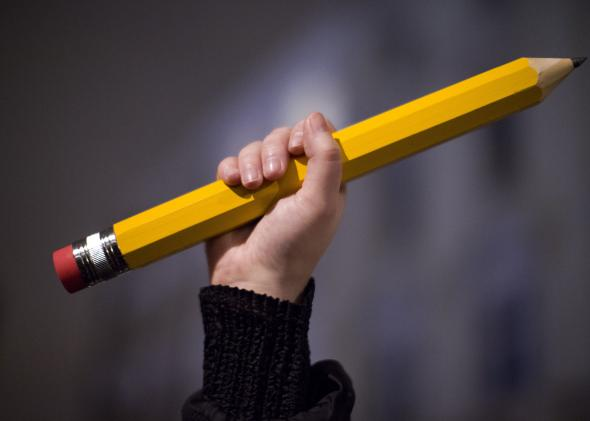 461237090-giant-pencil-is-held-up-at-a-vigil-outside-the-french