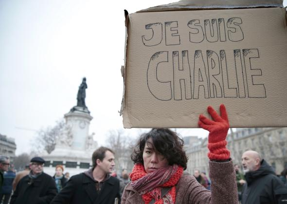 461124990-woman-holds-up-a-placard-that-reads-in-french-i-am