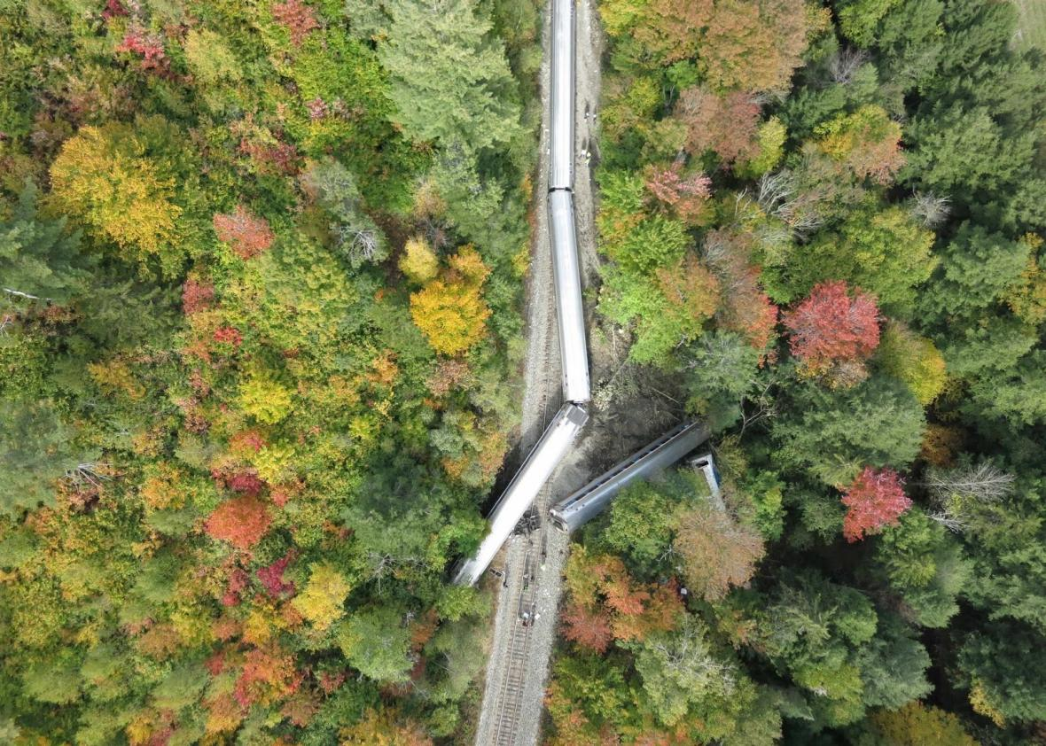 A photo from a drone operated by the Spatial Analysis Lab at the University of Vermont shows a derailed Amtrak train.