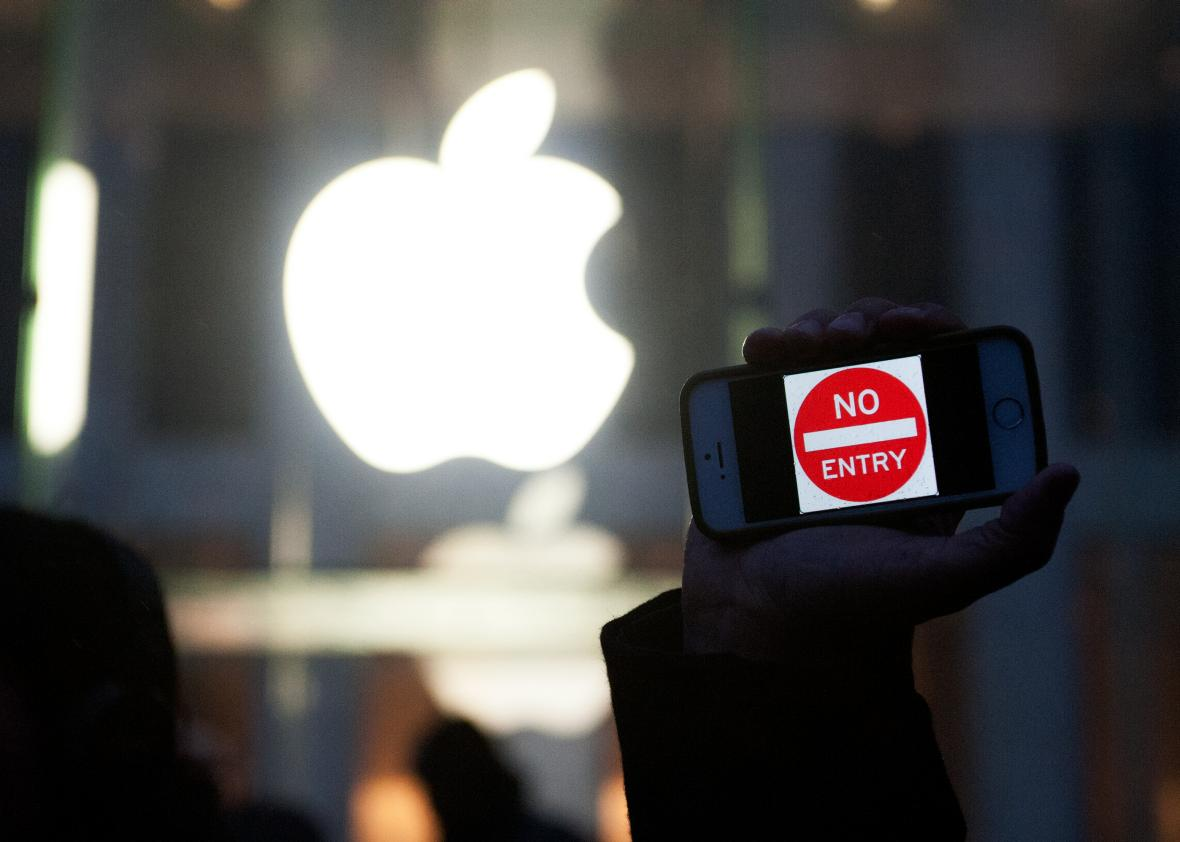 511899854-protestor-holds-up-an-iphone-that-reads-no-entry