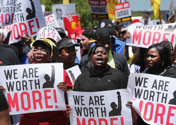 492723115-fast-food-workers-and-activists-demonstrate-outside-the
