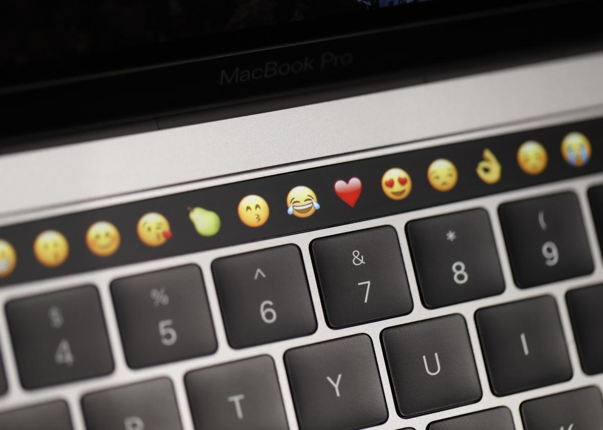 618595354-emoticons-are-displayed-on-the-touch-bar-on-a-new-apple
