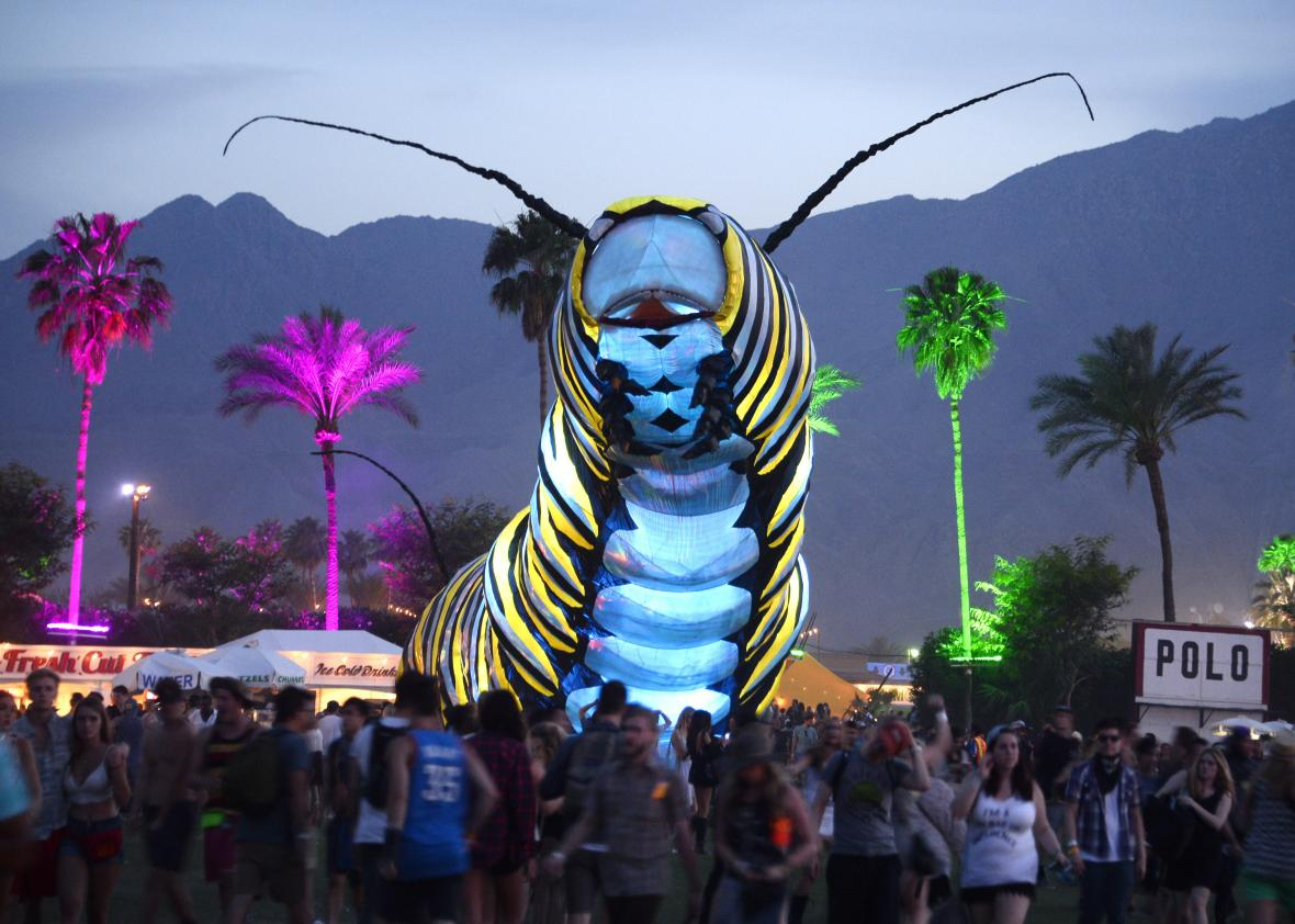 469276802-giant-caterpillar-moves-through-the-crowd-on-the-first