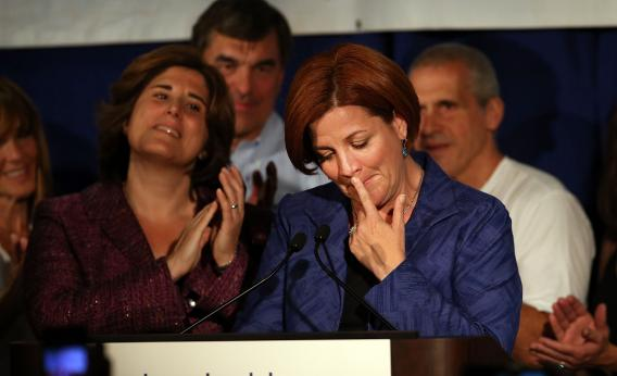 New York City Council Speaker Christine Quinn makes her concession speech. Her wife, Kim Catullo, is on her left.