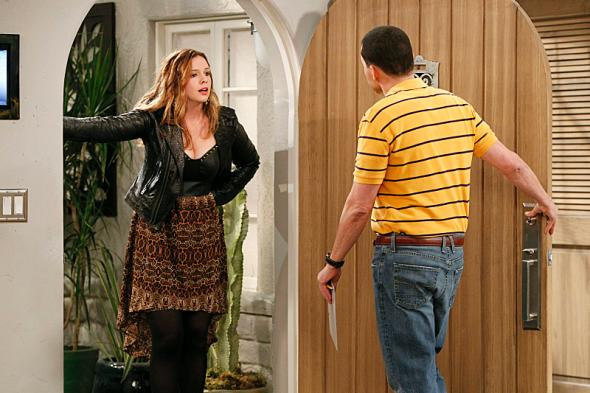 Amber Tamblyn as Jenny and Jon Cryer as Alan Harper in a scene from Two and a Half Men