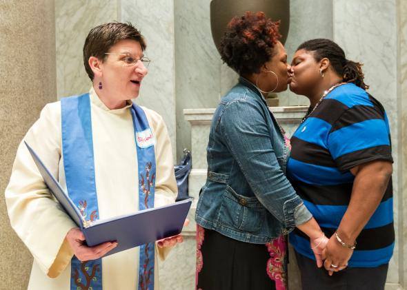 The Rev. Jennie Barrington performs the marriage ceremony of Amanda Boyd and Narkisha Scott at the Pulaski County Courthouse in Little Rock, Arkansas, on May 12, 2014.