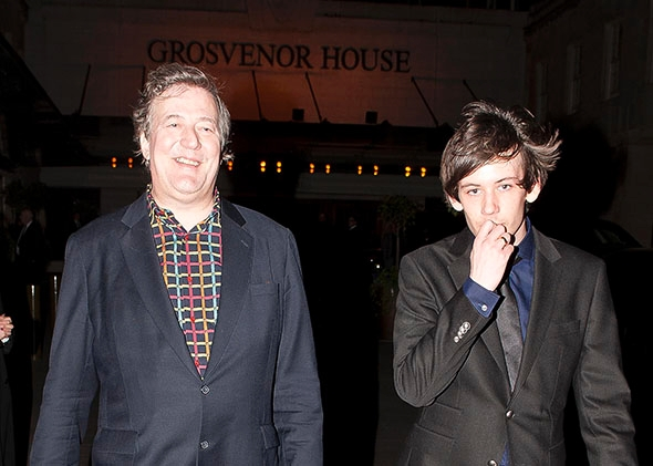 Stephen Fry and Elliott Spencer in London on March 30, 2014.