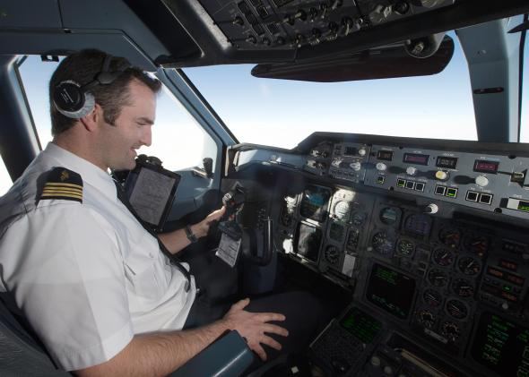 459963613-pilot-is-pictured-in-the-cockpit-of-an-a310-aircraft-of