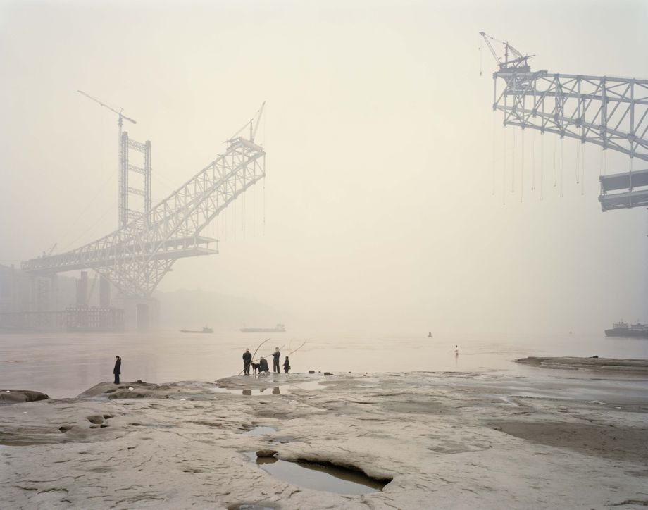 Photo of the Chaotianmen Bridge, the longest arched bridge in the world, under construction by Nadav Kander