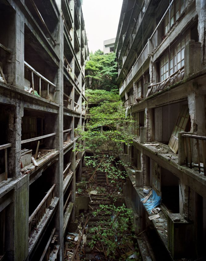 "Yves Marchand and Romain Meffre's photograph of the Japanese phantom island of Gunkanjima (""The Battleship""), once one of the most densely populated places in the world"