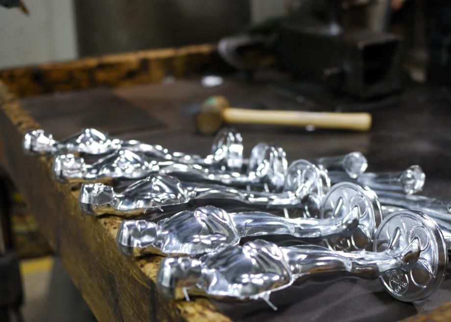 137613416-freshly-poured-oscar-statuettes-cool-on-a-table-at-r-s
