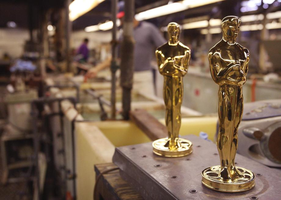79180303-oscar-statuettes-sit-on-a-workbench-in-the-plating-room