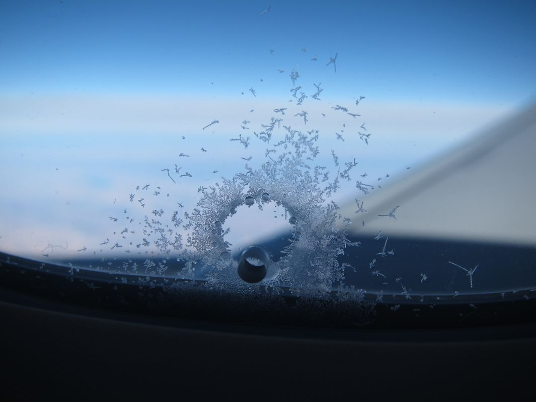 what u0027s that thing why are there holes in airplane windows