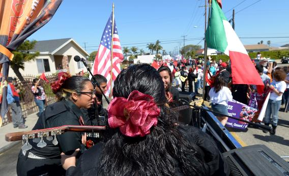 Hundreds of people march through the streets of Oxnard, Calif., for immigration reform and to honor the legacy of Cesar E. Chavez, founder of the United Farm Workers of America, on March 24, 2013.