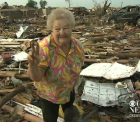 Tornado Survivor Finds Her Missing Dog in the Rubble of Her Home During a TV Interview