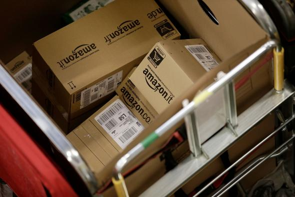 457850649-amazon-shipments-in-the-packet-and-parcel-section-of