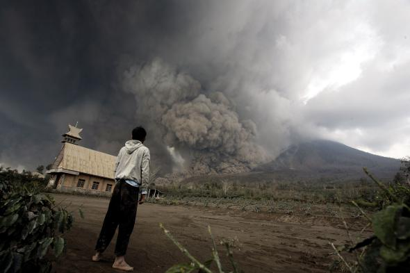 466349703-resident-looks-at-giant-volcanic-ash-clouds-from-a