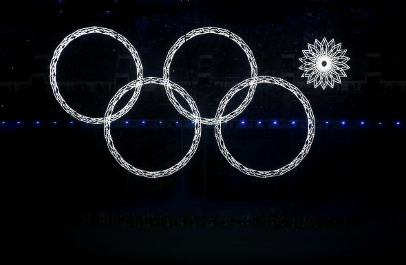 467578483-snowflakes-transform-into-four-olympic-rings-with-one