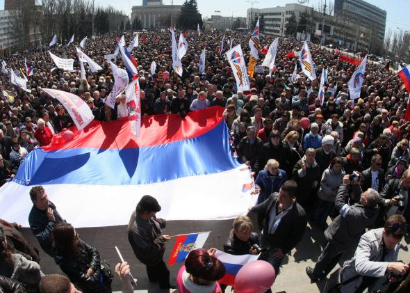 483055287-pro-russian-protesters-hold-russian-national-flags