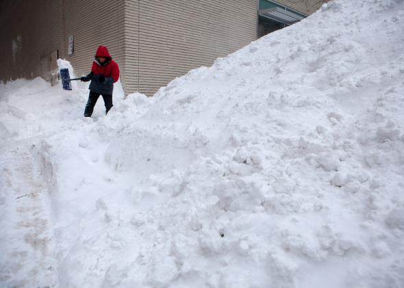 462407626-workers-continue-snow-removal-efforts-in-the-back-bay