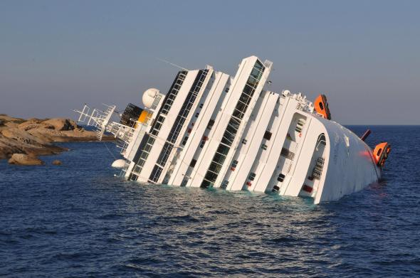 136991648-the-cruise-ship-costa-concordia-lies-stricken-off-the